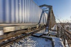 Train on an old bridge Stock Photo