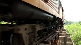 Train on old railroad near Kwai river, Thailand stock video footage