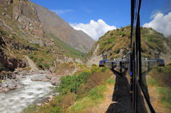 Train from Ollantaytambo goes to Machu Picchu. Royalty Free Stock Images