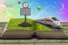 Train on open book with grass Stock Image