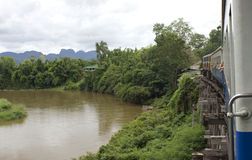 Train over Kwai. View of river Kwai from a train on Tham Krasae Bridge Stock Photography