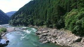 Train over river bridge stock footage