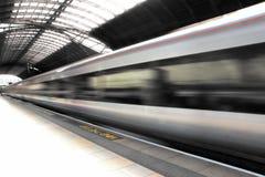 Train at Paddington Station. Train in blurred motion at Paddington Station in London, England Stock Photography