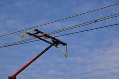 Train pantograph. Against blue sky royalty free stock image