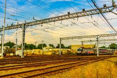 The train parked at the station. The train stoped at the station and there are many Railroad tracks Royalty Free Stock Image