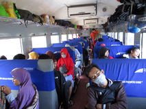 Train passangers. Economy class passenger train departed from the station in Surabaya, East Java, Indonesia Stock Photos