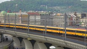The train of the passenger transport company RegioJet passes through the railway overpass. Prague. Prague, Czech Republic - April 23, 2018: The train of the stock video