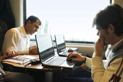 Train passengers. Picture of Train passengers busy with their work and laptops Royalty Free Stock Images