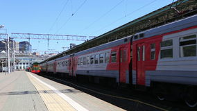 Train and passengers on Moscow passenger platform (Belorussky railway station) is one of the nine main railway stations in Moscow. Russia stock footage