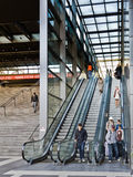 Train passengers using escalators. Stock Image