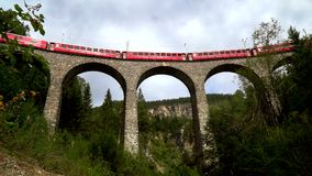 The train passes through the famous Landwasser viaduct in Switzerland. Bottom view. The train passes through the famous Landwasser viaduct in Switzerland. One stock video