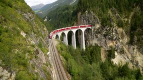 The train passes through the famous Landwasser viaduct in Switzerland. Top view. The train passes through the famous Landwasser viaduct in Switzerland. One of stock video