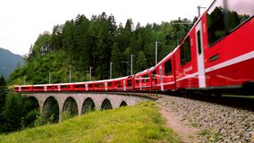 The train passes through the famous Landwasser viaduct in Switzerland. One of the biggest and most beautiful stock video