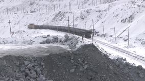 The train passes through the quarry. View from the window of the excavator on the empty cars of the electric train stock video