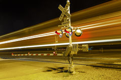 Train passes the railroad crossing with speed Royalty Free Stock Photography