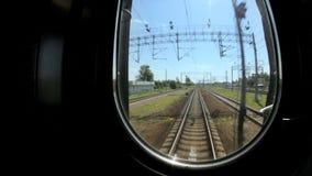 Train passes railroad station, railway communications stock footage