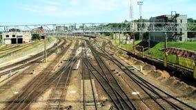 Train passes by railway near Vilnius railway station. VILNIUS, LITHUANIA - JUNE 14: Train passes by railway near Vilnius railway station, June 14, 2011 in stock video footage