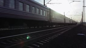 Train Passes By Railway At Sunset. Trans-Siberian Railway, Full HD Resolution 1920x1080 Video Frame Rate 29.97 Length 0:26 stock footage