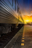 Train passing. By in orange sunset Stock Photos