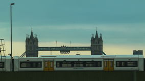 Train passing across the Thames, Tower Bridge at the background. Close up stock video