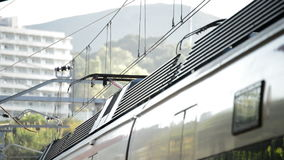 Train passing and arriving to station. Commuter train passing and arriving to station stock footage
