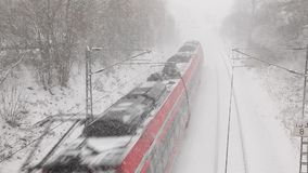 Train passing by during a blizzard stock video