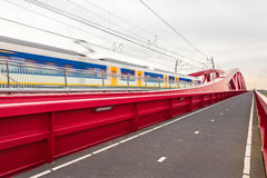Train passing a bridge in Overijssel, The Netherlands Royalty Free Stock Photos