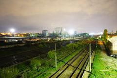 Night scene of rails and train in Carpati station, Bucharest, CFR Royalty Free Stock Images