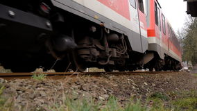Train passing by close on railway in Eifel Germany stock footage