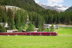 Train passing through Davos, Switzerland. Royalty Free Stock Image