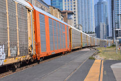 Train Passing with Downtown in the Background Stock Image
