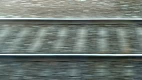 Train passing by. Fast Moving railroad tracks. Rails and sleepers quickly passing. Train passing by. Fast Moving railroad tracks. Rails and sleepers quickly stock video footage