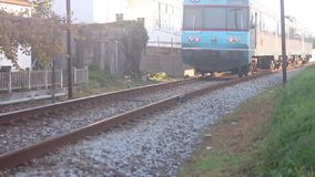 Train passing by [50fps]. Train passing by crossing  - sounds on ringing louder in S. Martinho do Porto - Portugal stock footage