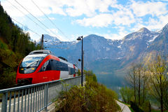 A train passing Hallstatt. A high speed train passing the Hallstatt station Stock Photography