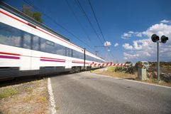 Train passing level crossing Stock Photography