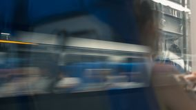 Train passing by. Loop. Train passing by shot through window with reflections. Seamless loop stock footage