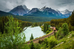 Train passing through Morant`s Curve in bow valley, Banff Nation stock photos