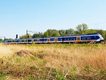 Train passing in a open field stock image