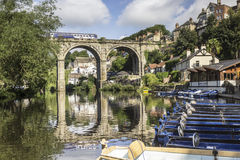 Train passing over arched bridge at Knaresborough, Yorkshire Royalty Free Stock Photo