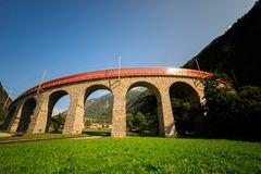 Brusio spiral Viaduct with train stock images