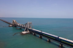 Train passing through Pamban Bridge stock photography