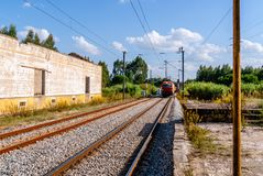 Train passing platform. A Diesel train seen speeding past a plat. Form in Coruche, Portugal Royalty Free Stock Photo