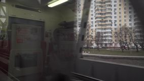 Train passing a railroad bridge in Moscow. View from the window stock video footage