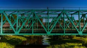 Train passing on the railway bridge Royalty Free Stock Image