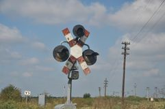 Train passing. By a railway-crossing with signal lamp deteriorated Stock Images
