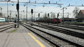 Train passing by railway station stock footage