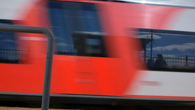 A train passing by the railway station stock footage