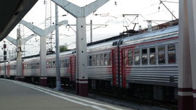 Train passing by the railway station. Passenger train passing by slowly the railway station on the first platform stock footage