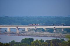 A train passing through a river bridge royalty free stock photography