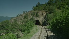 A train passing through a rocky area. A on board video of a Aatrain passing through a rocky area stock footage